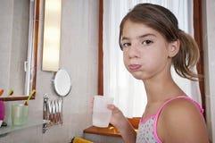 Brushing teeth in bathroom Royalty Free Stock Image
