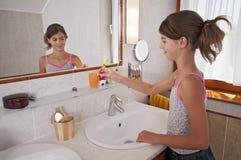 Brushing teeth in bathroom Stock Photo
