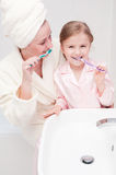 Brushing teeth together Royalty Free Stock Photography