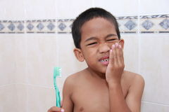 Brushing teeth vs. dental cavities Stock Photography