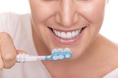 Brushing teeth. Woman actually brushing her teeth. Royalty Free Stock Images