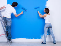 Brushing the wall by young couple Royalty Free Stock Photos