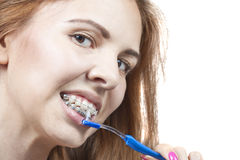 Brushing your teeth with braces Royalty Free Stock Photo