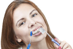Brushing your teeth with braces Stock Image
