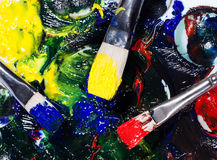 Brushs with tubes of paint an palette mixed colors Royalty Free Stock Photography