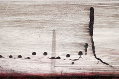 Brushstroke with black and red paint  on dusty metal fence Stock Image