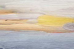 Brushstrokes of blue and yellow oil paint on canvas. Art background. Stock Images