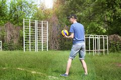 Brusilov, Ukraine - May 9, 2018: Athletic guy playing volleyball in the summer royalty free stock images