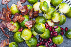 Brussel Sprout Bacon. Buttered brussels sprouts with bacon and pomegranate. New version stock photo
