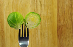 Brussel sprout and fork Stock Photo