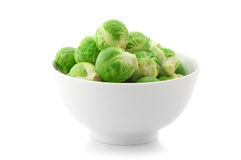 Brussel sprouts in bowl. Isolated on white background stock image