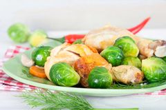 Brussel sprouts with carrot, onion, garlic and dill. Healthy homemade food stock images