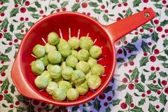 Brussel sprouts Christmas festive food in red bowl. Uk royalty free stock photo