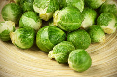 Brussel sprouts. Fresh brussel sprouts on wooden dish Royalty Free Stock Photo