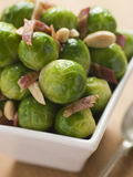 Brussel Sprouts with Fried Bacon and Almonds Stock Images