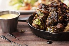 Brussel Sprouts roasted in an iron pan Stock Photo