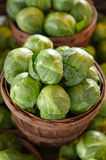 Brussel sprouts for sale on a market stall Stock Photo