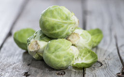 Brussel Sprouts. On wooden background (macro shot royalty free stock photo