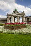 Brussels Arch. Famous Brussels Arch with spring flowers in front Stock Image