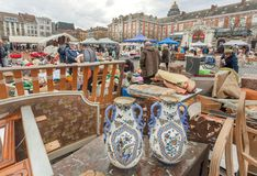 Flea market with old ceramic vases, bargains and antique stuff in boxes of vintage decor and retro details. BRUSSELS, BELGIUM - APR 3: Flea market with old Stock Photo