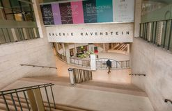 Man walking through shapping mall in Gallery Ravenstein, example of monumental modernism in architecture Stock Photo