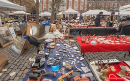 Marketplace on flea market with old art, bargains and antique stuff, vintage decor and retro details. BRUSSELS, BELGIUM - APR 3: Marketplace on flea market with Royalty Free Stock Image