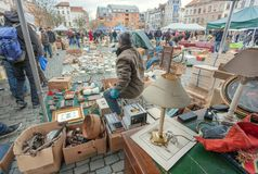 Sellers of flea market and bargains and antique stuff in mess of vintage decor and retro details. BRUSSELS, BELGIUM - APR 3: Sellers of flea market and bargains Stock Photography