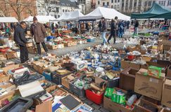 Traders of flea market and many old art, bargains and antique stuff in mess of vintage decor and retro details. BRUSSELS, BELGIUM - APR 3: Traders of flea market Stock Photos