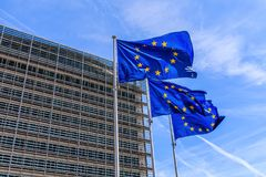 Brussels, Belgium. Flags of the European Union in front of the Berlaymont building in Brussels. royalty free stock photography