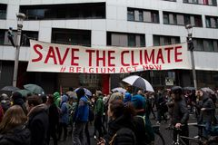 Brussels, Belgium - December 2, 2018 - More than 75000 people took on the streets of Brussels during the ClaimTheClimate march. To request stronger political royalty free stock images