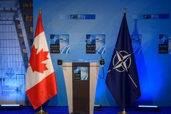 Flags of Canada and NATO, after press conference royalty free stock photography