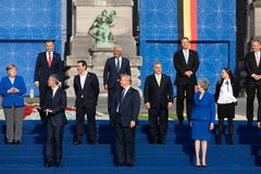 Group photo of participants of the NATO military alliance summit. BRUSSELS, BELGIUM - Jul 11, 2018: Jens Stoltenberg, Donald Trump, Angela Merkel and Teresa May stock image