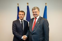 NATO military alliance summit in Brussels. BRUSSELS, BELGIUM - Jul 12, 2018: Ukrainian President Petro Poroshenko and French President Emmanuel Macron during royalty free stock photos