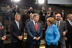 NATO military alliance summit in Brussels. BRUSSELS, BELGIUM - Jul 12, 2018: Ukrainian President Petro Poroshenko and German Chancellor Angela Merkel during NATO royalty free stock images