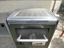 Brussels, Belgium - July 10th 2018: Solar garbage bin installed in London Square in Ixelles, Brussels. Royalty Free Stock Photo