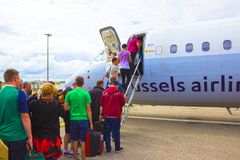 Brussels, Belgium - June 19, 2016: The people boarding the Brussels Airline aircraft. Passenger walking to the rear Stock Image