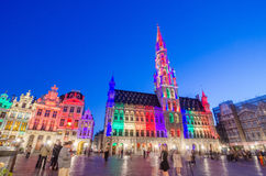 Brussels, Belgium - May 13, 2015: Tourists visiting famous Grand Place (Grote Markt) the central square of Brussels. Royalty Free Stock Image