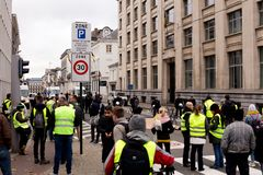 """Brussels, Belgium - November 30th, 2018: Protesters inspired by France's """"yellow vest"""" anti-tax movement. Are blocking Rue de la Loi street stock photos"""