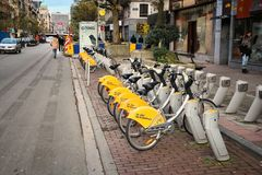 Brussels bike rental. BRUSSELS, BELGIUM - NOVEMBER 19, 2016: Villo city bicycle sharing station in Brussels, Belgium. The bike rent network has some 350 stations Royalty Free Stock Photo