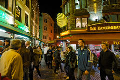 Brussels. BELGIUM - OCTOBER 26 : Rue Des Bouchers on October 26, 2013, , It is known as Brussel' belly, due to the many cafes and restaurants offering all Stock Images