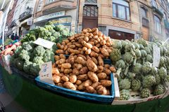 Broccoli potatoes and artichokes in market in Brussels. Brussels, Belgium, 18th February 2018. Farmer`s market on the street with fresh produce including Royalty Free Stock Image