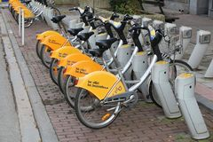 Brussels bicycle sharing. BRUSSELS, BELGIUM - NOVEMBER 19, 2016: Villo city bicycle sharing station in Brussels, Belgium. The bike rent network has some 350 Royalty Free Stock Images