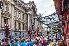 Brussels, bourse, street cafe. BRUSSELS, BELGIUM-MAY 21, 2016: Locals and tourists enjoy to sit outside on the terrace of a cafe next to the Bourse in the city Stock Photo