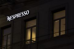 Brussels, brussels/belgium - 13 12 18: nespresso sign in brussels belgium in the evening. Brussels, brussels/belgium - 13 12 18: an nespresso sign in brussels royalty free stock photo
