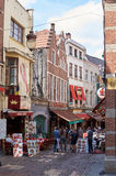Brussels, Butcher's street (rue des bouchers). Brussels, Belgium - July 31, 2015: Butcher's street (rue des bouchers). People enjoy a meal time in the street Stock Images