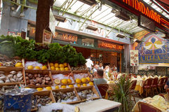 Brussels, Butcher's street (rue des bouchers). Seafood restaurant. Brussels, Belgium - July 31, 2015: Butcher's street (rue des bouchers). People eat in a royalty free stock photo