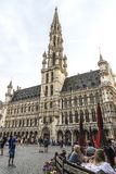 Brussels City Hall at the Grand Place in Brussels, Belgium. Brussels, Belgium - August 26, 2017: Brussels City Hall at the Grand Place with people walking around Royalty Free Stock Photography