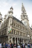 Brussels City Hall at the Grand Place in Brussels, Belgium. Brussels, Belgium - August 26, 2017: Brussels City Hall at the Grand Place with people walking around Royalty Free Stock Images