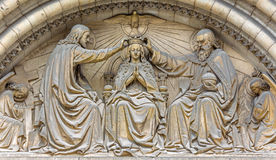 Brussels - The Corronation of Virgin Mary on the man portal of Notre Dame de la Chapelle gothic church. stock photo