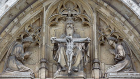 Brussels - The Holy Trinity on the east portal of Notre Dame de la Chapelle gothic church. Stock Image